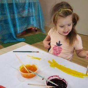 Cleveland Early Learning Centre - Child making art