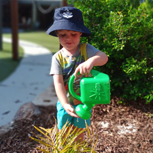 Cannon Hill Early Learning Centre - Child watering plants