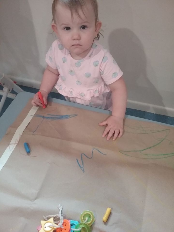 Baby drawing on paper - Daisy Hill Early Learning Centre