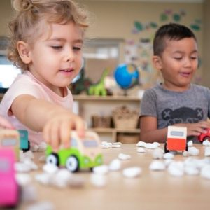 Kids Playing With Toy Cars on the Table - Cleveland Early Learning Centre