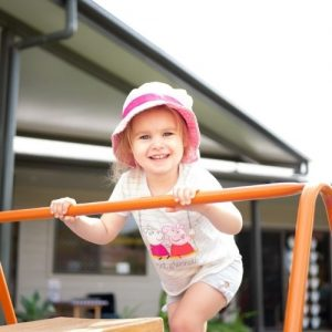 Kid Playing Outdoor and Smiling at the Camera - Cleveland Early Learning Centre