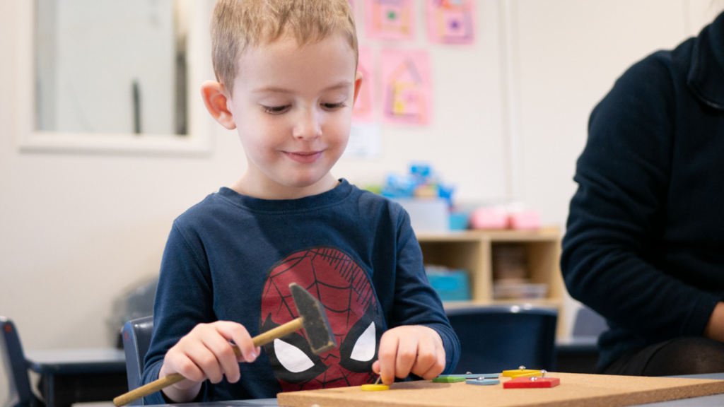 Child Doing Sensory Play - Early Learning Centre