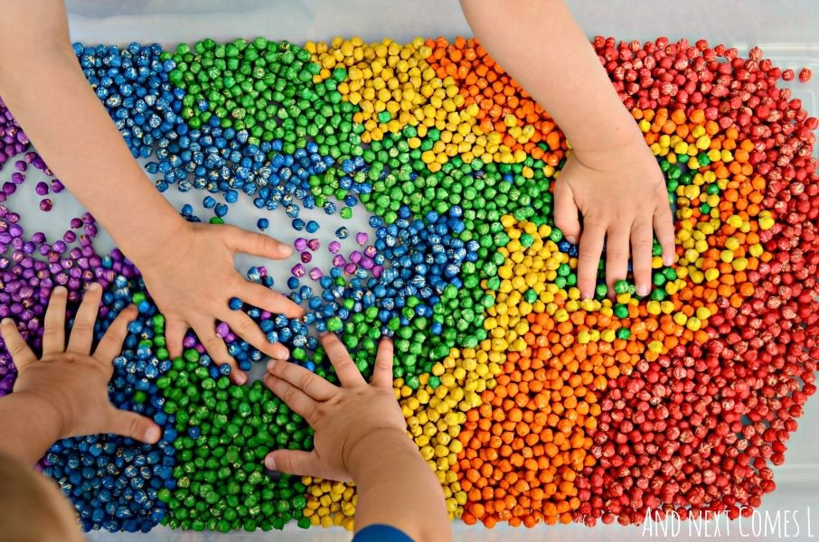 Kid's Hands Playing With Colored Rainbow Rocks - Daisy Hill Early Learning Centre