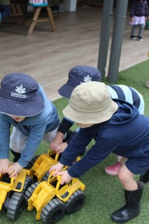 Children playing with toy trucks - Cannon Hill Early Learning Centre