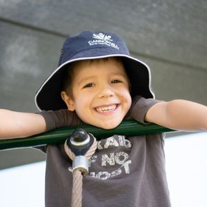 A Kid Smiling in the Camera - Cannon Hill Early Learning Centre