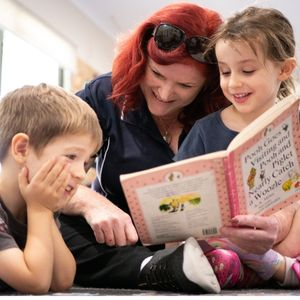 A Teacher Letting Kids Read the Book - Cannon Hill Early Learning Centre