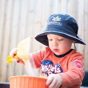 A Child Playing With a Sand and Bucket - Cannon Hill Early Learning Centre